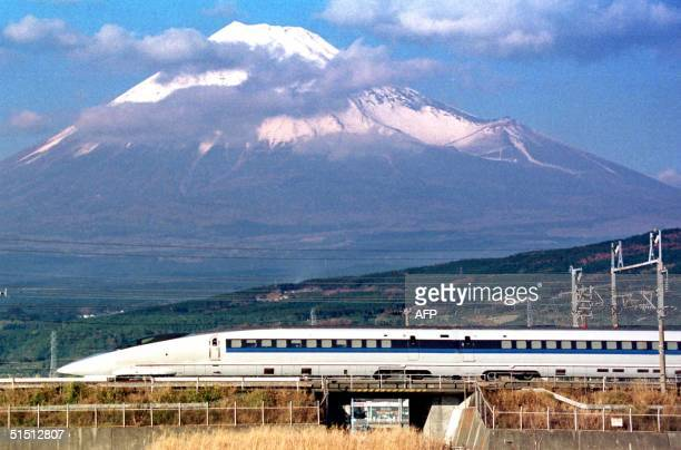 This recent file picture shows a bullet train 500type speeding in front of Mt Fuji in Shizuoka AFP PHOTO