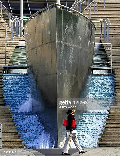 This recent photo shows a woman walking past the waterfall and bow of a ship entrance to Sydney's Star City complex Sydney's premier entertainment...