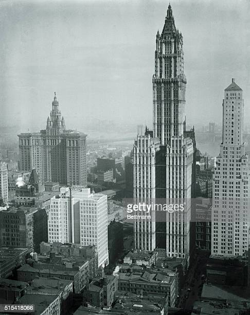 This recent photograph taken from the new Telephone Building in New York shows the Woolworth Building and Tower in the center while her skyscraping...