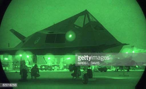 This recent picture shows an airman maintenance personnel working under a F117A Stealth Fighter at Ahmed AlJaber Air Base in Kuwait This is one of...