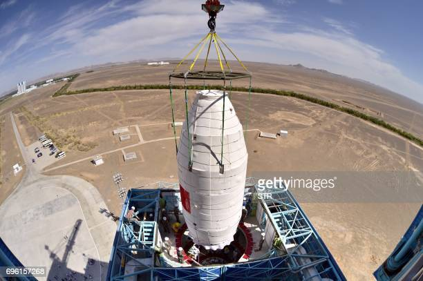 This recent undated photo shows the Hard Xray Modulation Telescope named Insight being lifted onto a Long March4B rocket at the Jiuquan Satellite...