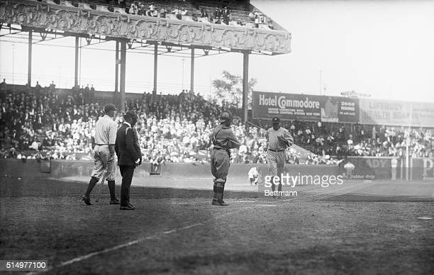 This remarkable photo taken at the Polo Grounds today shows Babe Ruth starting out on what proved to be his twentyfirst home run of the season The...