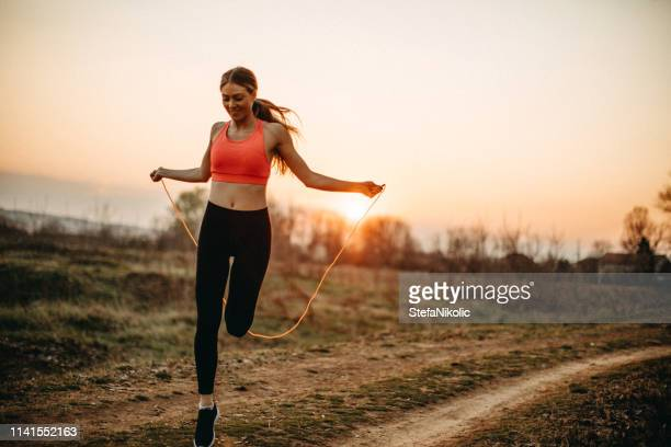 this rope is good for cardio - skipping along stock photos and pictures