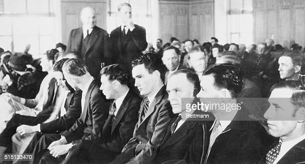 This row of men are on trial in Federal Court in Dallas, Texas, charges with aiding and concealing Clyde Barrow and Bonnie Parker, killers who were...