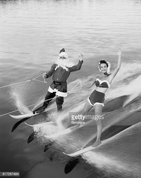 This Santa Claus helper has left Rudolph the RedNosed Reindeer and his sleigh up north and has taken to water skiing at Cypress Gardens Florida He...