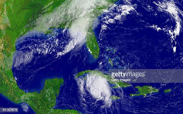This satellite handout from the National Oceanic and Atmospheric Administration shows Tropical Storm Bonnie making landfall on the Gulf Coast as...