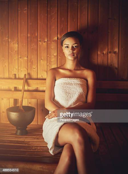 this sauna feels amazing - black woman in sauna stock pictures, royalty-free photos & images