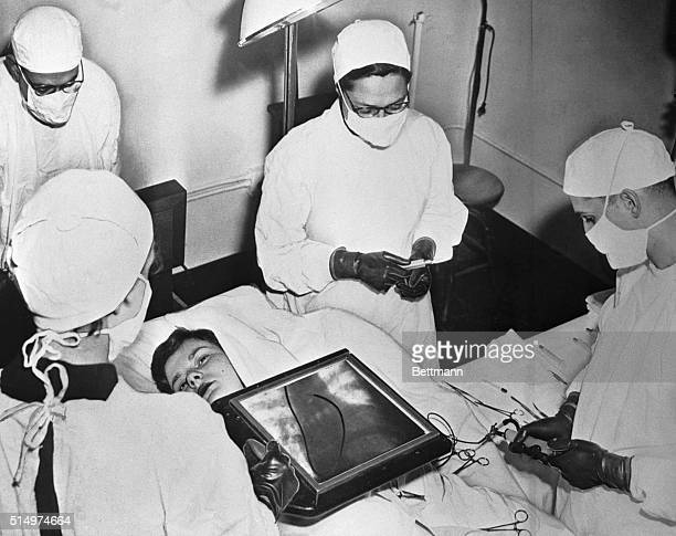 This scene at the Presbyterian Hospital in Chicago reveals how science has progressed to bare secrets of heart abnormalities heretofore discovered...