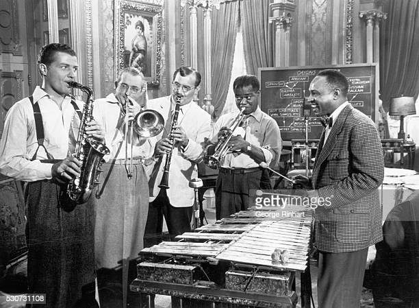 This scene from RKO's A Song is Born a film devoted to the development of jazz shows a group of famous jazznames having a session together Pictured...