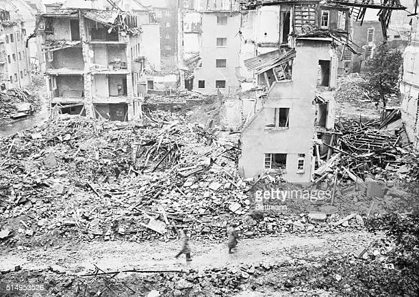 This scene in Aachenforst 150 yards from the besieged city of Asachen shows buildings reduced to rubble by artillery and mortar fire following the...