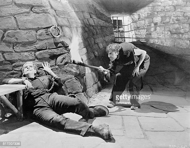 This scene shows Boris Karloff chained to his cell and Dwight Frye in a 1931 movie.