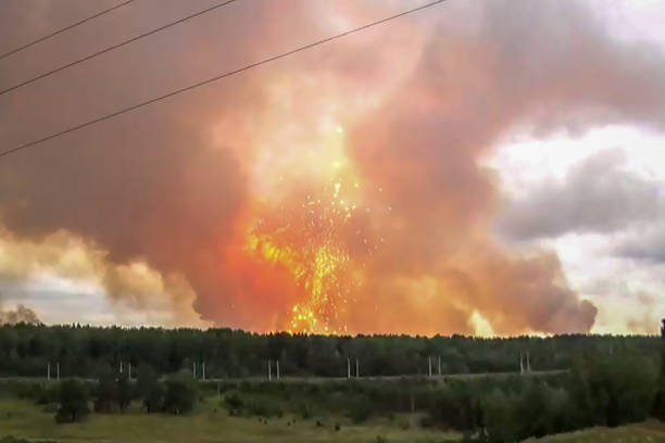 TOPSHOT This screen grab from a video made on August 5 2019 shows explosions at an ammunition depot near the town of Achinsk in the Krasnoyarsk...