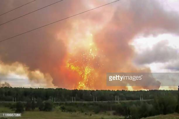 This screen grab from a video made on August 5, 2019 shows explosions at an ammunition depot near the town of Achinsk in the Krasnoyarsk region. - Up...