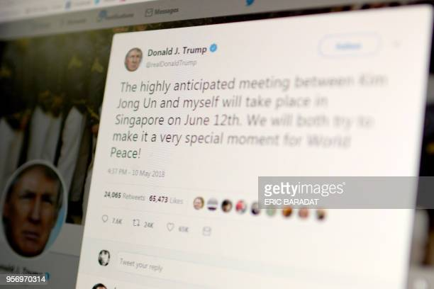 This screen grab shows a message tweeted by US President Donald Trump as he announced on May 10 2018 his historic summit with North Korean leader Kim...