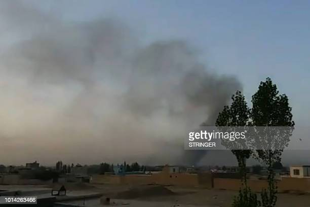 TOPSHOT This screen grab taken from AFPTV video on August 10 2018 shows smoke rising into the air after Taliban militants launched an attack on the...