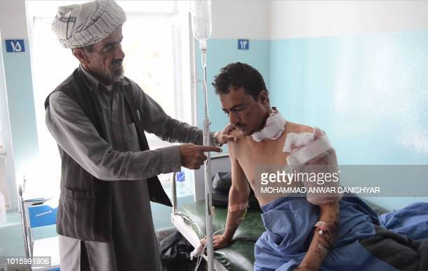 This screen grab taken from AFPTV video on August 13 2018 of video shot on August 12 shows an injured man receiving medical treatment at Ghazni...