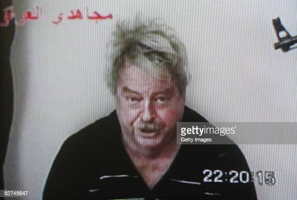 This screen grab taken from Sky News shows the broadcast of a message released to media outlets in which hostage Douglas Wood of Australia pleads for...