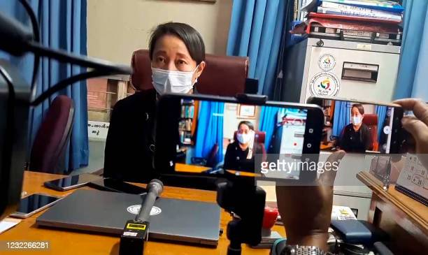 This screengrab from AFPTV video footage taken on April 12, 2021 shows Min Min Soe, lawyer for Aung San Suu Kyi who was detained in the February...