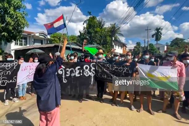 This screengrab from AFPTV video footage taken on May 11, 2021 shows protesters taking part in a demonstration against the military coup in Yangon,...