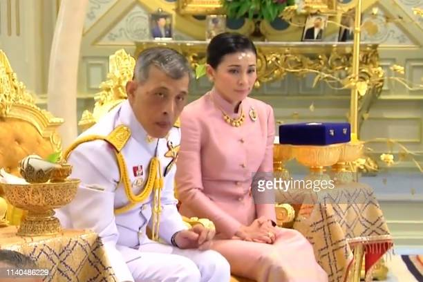 This screengrab from Thai TV Pool video taken on May 1 2019 shows a ceremony in which Thailand's King Maha Vajiralongkorn legally married Suthida...