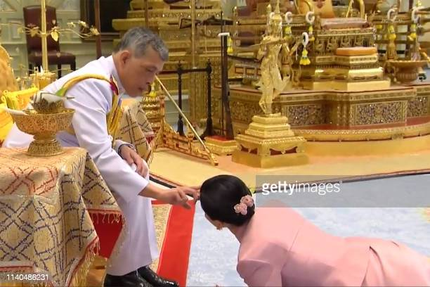TOPSHOT This screengrab from Thai TV Pool video taken on May 1 2019 shows a ceremony in which Thailand's King Maha Vajiralongkorn legally married...