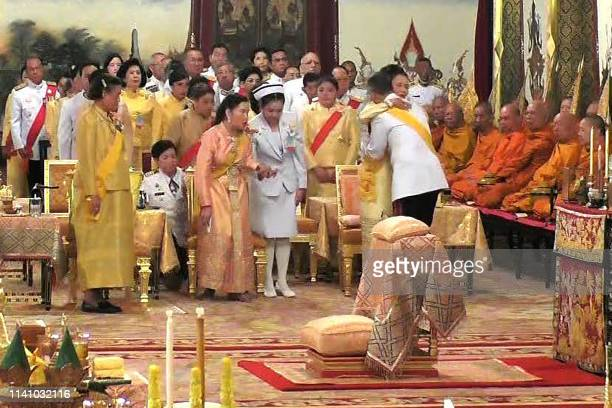 This screengrab from Thai TV Pool video taken on May 3 2019 shows Thailand's King Maha Vajiralongkorn hugging his sister Princess Ubolratana as...