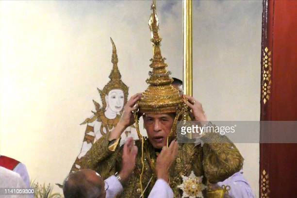 This screengrab from Thai TV Pool video taken on May 4 2019 shows Thailand's King Maha Vajiralongkorn as he is crowned during his coronation in...