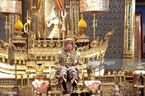 TOPSHOT This screengrab from Thai TV Pool video taken on May 4 2019 shows Thailand's King Maha Vajiralongkorn facing the audience wearing the gold...