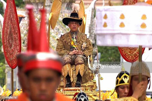 This screengrab from Thai TV Pool video taken on May 4 2019 shows Thailand's King Maha Vajiralongkorn sitting on a royal palanquin carried by...