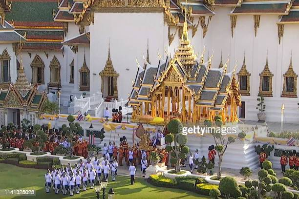 This screengrab from Thai TV Pool video taken on May 5 2019 shows an aerial view of the Grand Palace with Thailand's King Maha Vajiralongkorn carried...