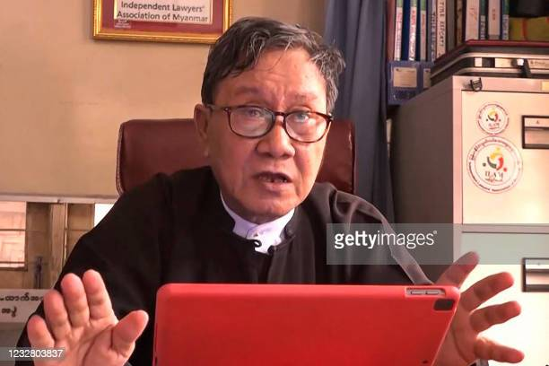 This screengrab provided via AFPTV video footage taken on May 10, 2021 shows Khin Maung Zaw, lawyer for detained civilian leader Aung San Suu Kyi who...