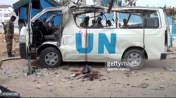 This screengrab taken from Anadolu Agency footage shows people gather around a destroyed vehicle belonging to the United Nations in Garowe the...