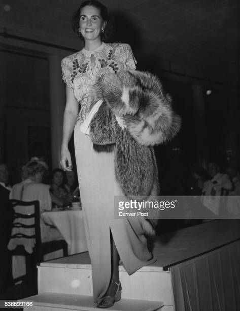 This Seacap Green beaded dinner gown from GanoDowns' fall fashion showing was modeled by Mrs Richard Kearns at the Denver Country club The graceful...