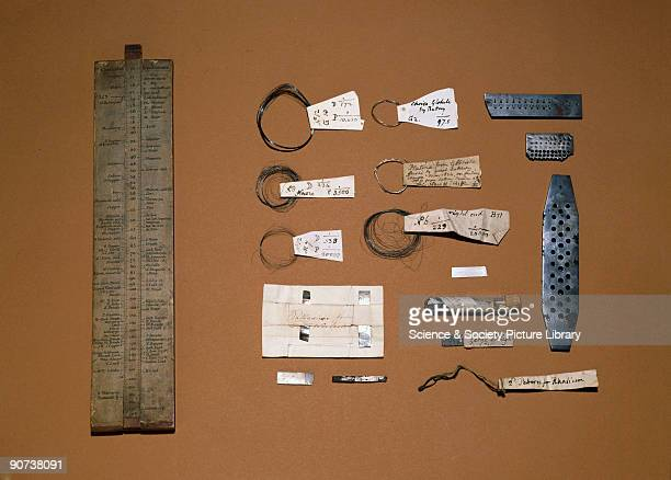 This selection of items includes Wollaston's slide rule of chemical equivalents and samples of platinum palladium and rhodium with metal dies used to...