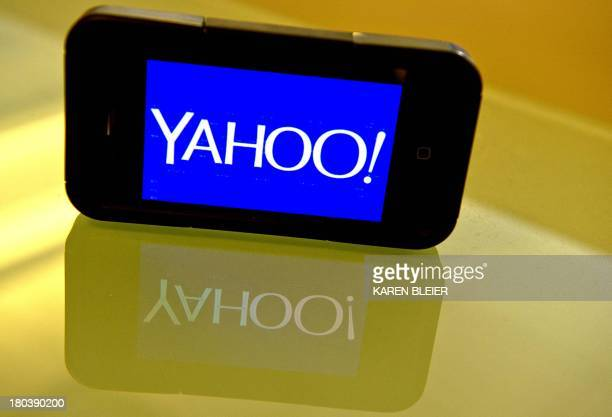 This September 12, 2013 photo illustration shows the newly designed Yahoo logo seen on a smartphone. Yahoo has refreshed its logo for the first time...