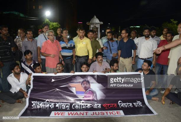 This September 20 2017 photo shows Indian journalists at a road blockade set up over the killing of journalist Shantanu Bhowmick in front of the...
