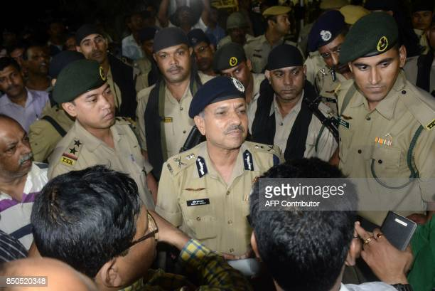 This September 20 2017 photo shows Indian police speaking to journalists at a road blockade set up over the killing of journalist Shantanu Bhowmick...