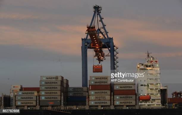 This September 21 2017 photo shows a container being loaded onto a ship at the Vizag Terminal operated by Essar Ports Indias second largest private...