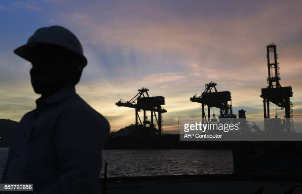 This September 21 2017 photo shows an employee of Essar Ports Indias second largest private port operator in the berthing area of the Vizag Terminal...