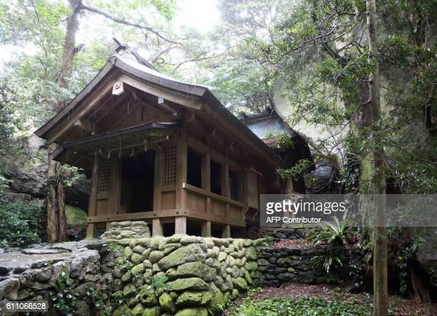 This September 30 2016 picture shows Okitsugu shrine of the Munakata Taisha at Okinoshima island some 60 kilometres from Munakata city Fukuoka...