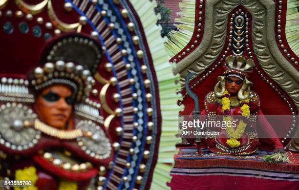 This September 6 2017 photo shows Indian 'Theyyam' artists performing during the 'Kummati Kali' as part of the annual Onam festival celebrations in...