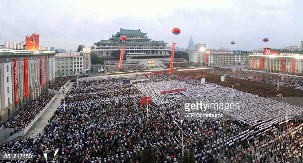 This September 6 2017 picture released from North Korea's official Korean Central News Agency on September 7 2017 shows Pyongyang residents and...