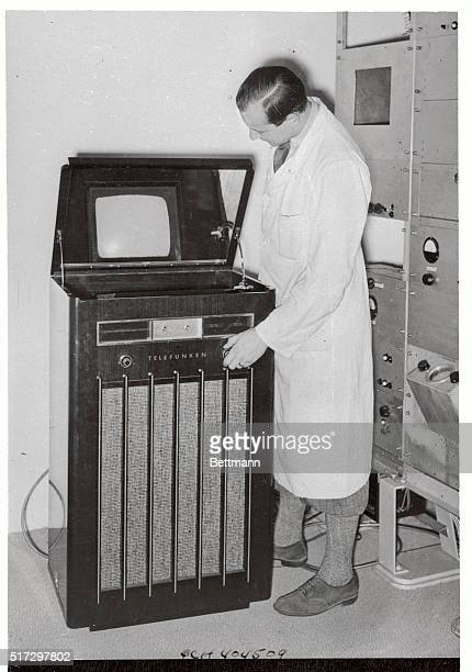 This set featuring 441line transmissions is being shown at a current radio exhibition in Berlin The television screen is seen indirectlyreflected in...
