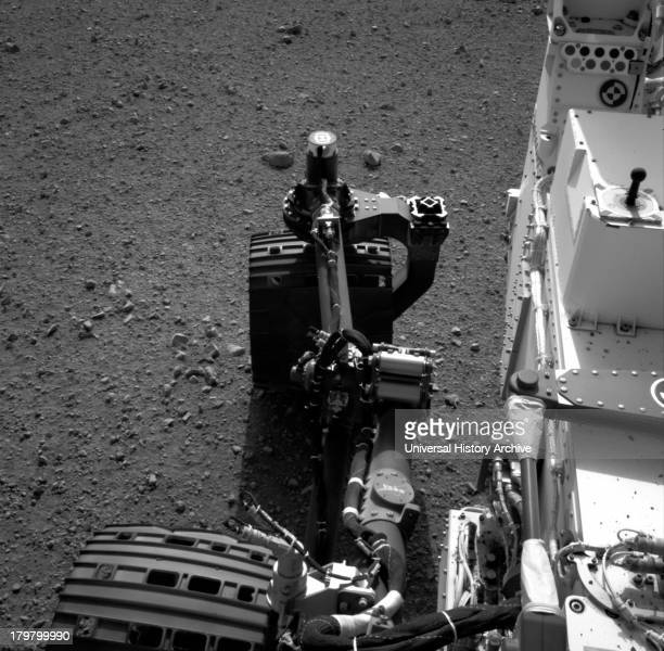 This set of images shows the movement of the rear right wheel of NASA's Curiosity as rover drivers turned the wheels in place at the landing site on...