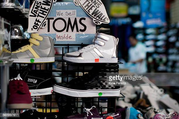 This shop in Santee Alley is advertising Van's and Tom's shoes for very low prices Many counterfeiters are faking name brands which sell for much...