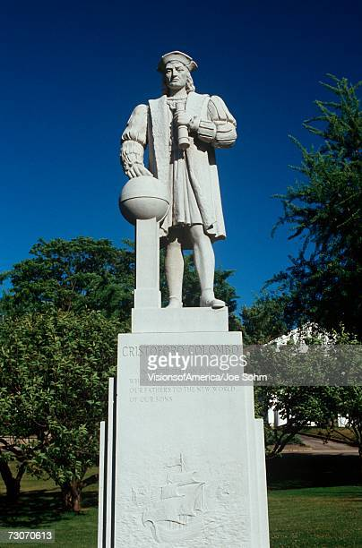 'This shows a statue of Christopher Columbus, in an outdoor, public area. It is situated on a pedestal commemorating 500 years since his discovery of America.'