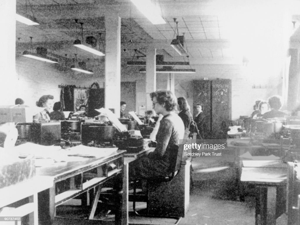 This shows codebreakers using modified British Typex cipher machines in Hut 6 at Bletchley Park, Milton Keynes, Buckinghamshire. Bletchley Park was the British forces' intelligence centre during WWII, where cryptographers deciphered top-secret military communiques between Hitler and his armed forces. These communiques were encrypted in the Lorenz code which the Germans considered unbreakable, but the codebreakers at Bletchley cracked the code with the help of 'Colossus', the world's first electronic programmable computer, and so aided the Allies victory.
