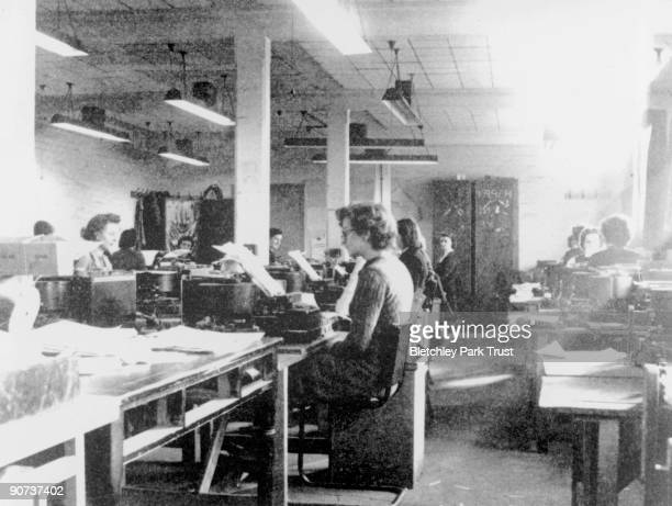 This shows codebreakers using modified British Typex cipher machines in Hut 6 at Bletchley Park Milton Keynes Buckinghamshire Bletchley Park was the...