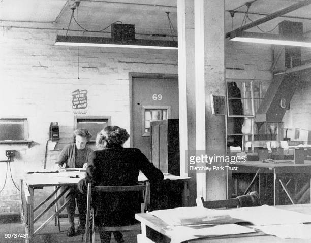This shows personnel in the registration room in hut 6 at Bletchley Park Buckinghamshire the British forces' intelligence centre during WWII The...