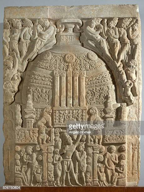 This shows the decorations on a Buddhist stupa from the third century AD found in Nagarjunikonda India A stupa is a Buddhist shrine This one is...